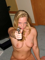 Dangerous And Beautiful Blonde Loves To Pose With Gun