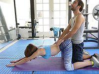 Personal Trainer Help Her Working On Her Lower Back
